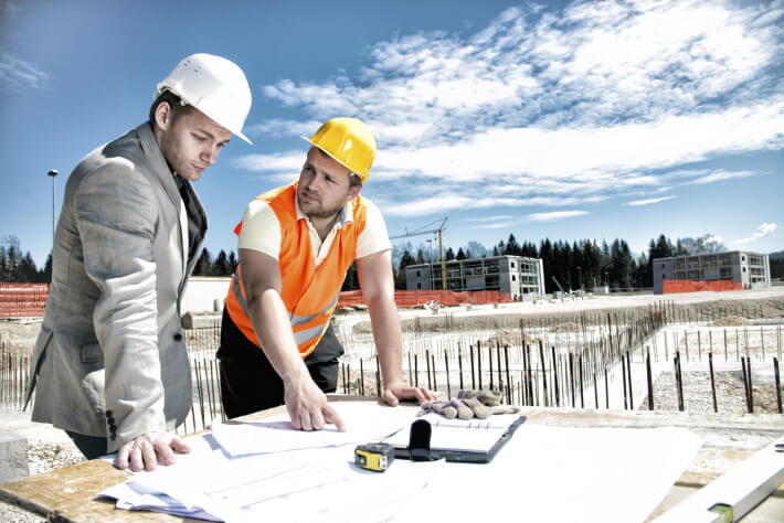 Contractor Accountant Examining Blueprint